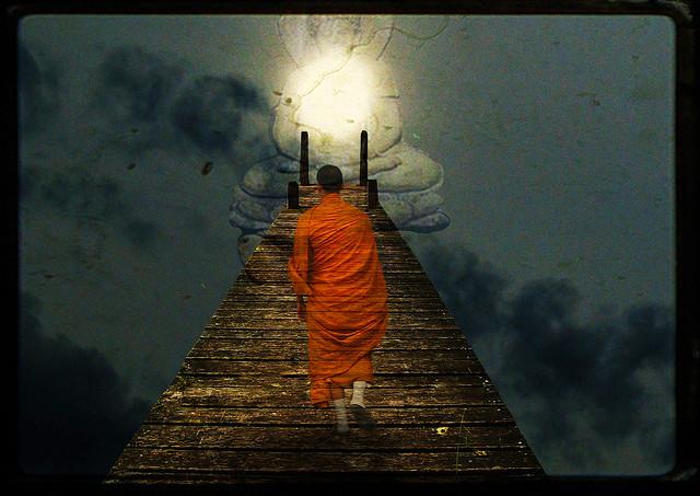 Monk on bridge